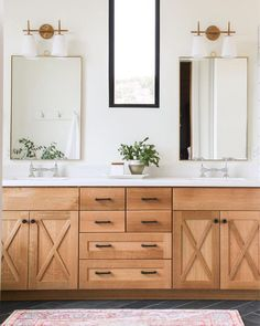 Wood vanity cabinet detail in bathroom.