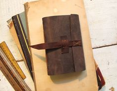 Leather journal with closure by Quill and Arrow Press. Leather Books, Handmade Books, Leather Journal, Leather Cover, Quilling, Arrow, Closure, Etsy, Bedspreads