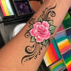 Interesting brush stroke effect from the black almost-tribal lines Nadine Davidson Face Painting Flowers, Adult Face Painting, Face Painting Designs, Body Art Tattoos, Sleeve Tattoos, Cool Tattoos, Folk Art Flowers, Arm Art, Painting Tattoo