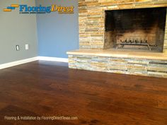 Notice the beautiful cut-under that Flooring Direct Texas did with the fireplace in this hardwood floored room. Cut-unders such as this take precision and skill, but the end result is well worth it!  #flooring #FlooringDirectTexas #Dallas #DFW #hardwood #fireplace