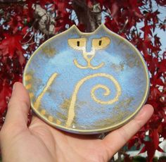 Pottery Cat plate round dish handmade clay rustic blue yellow eyes.