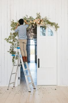 Learn how to DIY a flower doorway arch! So gorgeous and you can use whatever flower combination you want.