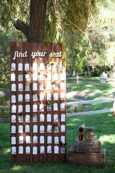 amazing escort card holder -- looks like distressed wood.  love the wood crates, vintage scale and brown glass, too.