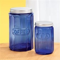 "Storing coffee and tea in retro style, our cobalt jars feature twist-off chrome lids for modern freshness. Ridged glassware has the nostalgic look you love of Depression-style glass. Each features embossed ""COFFEE"" or ""TEA"" 334332 Cobalt Blue Glass Coffee Jar - $17.99"