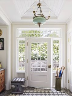 Step Inside Designer Philip Mitchell S Century Seaside Cottage Shiplap Vault In Ceiling And A Marble Floor That Has The Year The Cottage Was Built 1795 In The Marble Entryway Tile Foyer Decorating, Colonial Decorating, Entry Foyer, Front Entry, Cottage Interiors, Step Inside, House Tours, Interior And Exterior, Luxury Interior