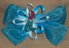Mermaid in waves hair bow is so beautiful worn.Handmade one of a kind item.Can be worn casually or formally. Anyone of all ages can wear it. It's sure to bring lots of fun and great compliments to you