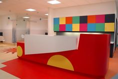 Adding fun colours with Corian® for kids hospital reception counters.