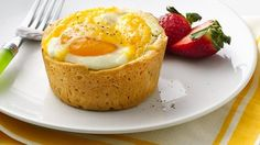 Bacon and cheese in a biscuit cup topped with an egg... Breakfast can not get any better than that!