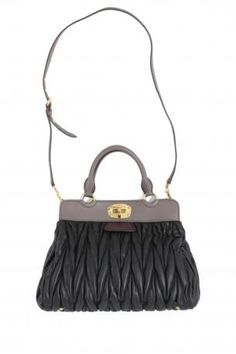 miu miu shopping bag in black matelasseé leather with grey and burgundy red  details. The 5b59b7393525a