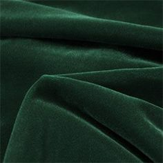 This is a solid dark green velvet light weight upholstery or drapery fabric, suitable for any decor in the home or office. Perfect for pillows, cushions and furniture.v272PIEF