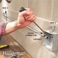 How to Install Surface-Mounted Wiring and Conduit - Anna Maria Interior With metal conduit, you can run power almost anywhere. We'll show you how to do it safely and easily. Electrical Conduit Fittings, Home Electrical Wiring, Electrical Projects, Electrical Outlets, Electrical Engineering, Conduit Bending, Simple Arduino Projects, Diy Projects, House Wiring