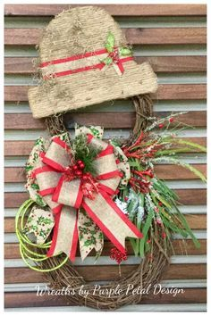 Totally awesome snowman grapevine wreath for winter and Christmas. Two sizes of grapevine wreaths are attached to form a snowman. I have