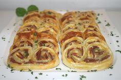 23 - Blätterteigschnecken mit Salami & Kräuterfrischkäse - Seitenansicht / Puff pastry pretzels with salami & herb cream cheese - side view