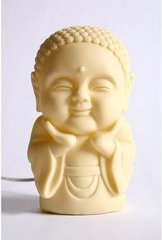 it reminds me to smile and not care that i eat an extra cookie. :) happy buddha