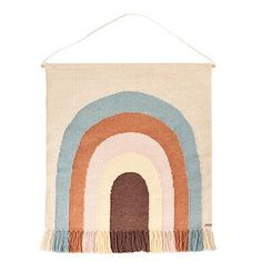 Gorgeous rainbow wall rug from OYOY. These Scandinavian designer wool rugs are designed to hang from any wall and has a pretty rainbow design. The neutral style means it will look great in any children's bedroom or nursery.