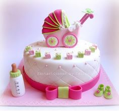 Pink and green baby carriage cake.