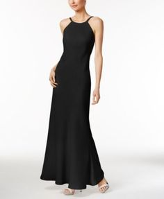 Stun for your special occasion in this elegant, crisp gown from Calvin Klein. | Polyester; lining: polyester | Professional Dry Clean Only | Imported | Back zipper closure | Sleeveless | Open back | S