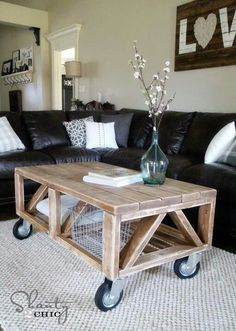I love this coffee table. Seems like a pretty simple DIY. Paint the bottom pieces white, stain the top?