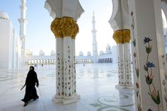 """Desert Flower, 2013 Photograph by Dave Yoder  """"The Sheikh Zayed Mosque in Abu Dhabi is a popular place to take pictures because it's so photogenic,"""" says Dan Westergren. """"You just line up the shot and wait for someone to come by. The figure is blurry, but you can tell she's looking up—which is what everybody does when they walk through this grandeur."""""""