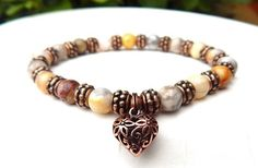 About the Bracelet Sweet and serene gemstone bracelet. Crazy Lace agate is a stone of the spiritual love of good, paired here with an amazingly beautiful heart charm. Bracelet Details: This beautiful
