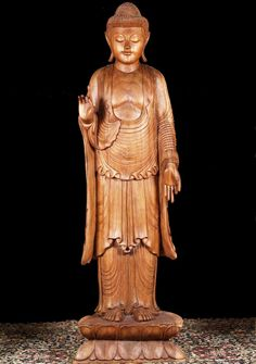 Image from http://www.lotussculpture.com/mm5/graphics/00000001/1-large-wood-buddha-statue.jpg.