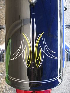 Pinstriping by gorygreg. He'll be here at the Motorcycle Round-UP June 9th!