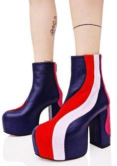 Current Mood Jawbreaker Platform Boots ...you may think I'm groooovy, but I think you SUCK! Stomp 'em out in these totally retro platform BBs, featurin' a super smooth navy blue vegan leather construction, ultra tall block heel 'N covered platform, wavy vegan suede swirls down the heel 'N outer facing side in red, lilac, and magenta, and back zip closures for a sleek fit.