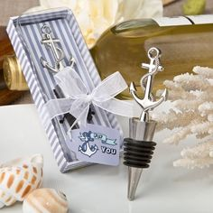 Nautical Themed Anchor Bottle Stopper (FashionCraft 1960) | Buy at Wedding Favors Unlimited (http://www.weddingfavorsunlimited.com/nautical_themed_anchor_bottle_stopper.html).