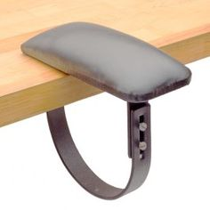"""Jeweler's Bench Arm Rest - Support your arm when working at your jewelry bench or tabletop. The ergonomically designed padded armrest simply slides onto a desk or bench to help alleviate arm fatigue and steady your arm when working for long periods of time. Vertically adjustable for bench top thicknesses from 1.5"""" to 2.5""""."""