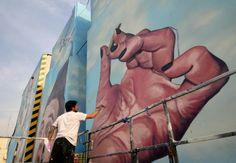 http://buenosairesstreetart.com/2013/08/martin-ron-completes-fantastic-new-mural-in-villa-urquiza/