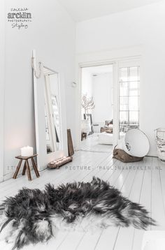 mirror on floor with small stool or table?