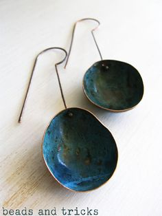 Earrings in copper and blue patina forged