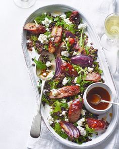 This French-inspired sausage, lentil and goat's cheese salad with black olive tapenade dressing makes a real family-pleaser and a filling salad main. Hot Sausage, Sausage Rolls, How To Cook Sausage, Sticky Sausages, Cheese Log, Bangers And Mash, Lentil Stew, Beef Bourguignon, Goat Cheese Salad
