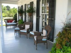 I love southern style front porches, in fact i love southern living home styles lol...in this picture, i'm really digging the whole deco., looks great!