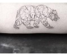 Dr Woo excelle dans les tatouages géométriques