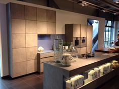 concrete kitchen design by zeyko shown in picture highlights the different use of units for this range available at rowat & gray in canary wharf london