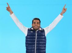 Gold medalist Martin Fourcade of France celebrates during the medal ceremony for the Men's Individual 20 km