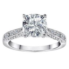 This ring is GORGEOUS. It is so beautiful - no one has a clue that it's not a diamond. The band is VERY thin - thinner than it looks in the pictures, and the white topaz is large. It's not too large, though. I was worried that it would look like costume jewelry, but it just looks like a really expensive engagement ring.