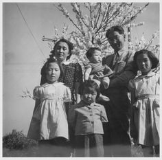 A typical Nisei family of Heart Mountain Relocation Center  are Mr. and Mrs. Thomas Oki and their small daughter, Dinne. 1944