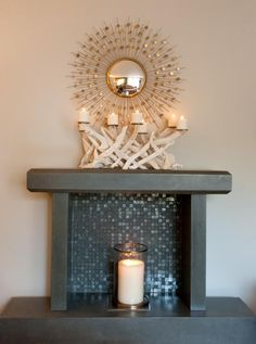 great mantle with driftwood candelabra & sunburst mirror Designed by Julie Molnar ~ photo Heather Ross