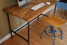 Industrial Desk with Oak Top and Steel Pipe Legs by Urban Wood Goods:  for the husband's office?