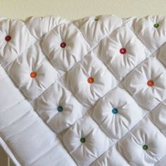 button quilting.on a standard white or plain color comforter~ so pretty!