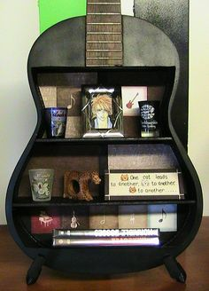 Upcycled Acoustic Guitar Shelf. Idk if I could bring myself to do that to a guitar but really cool idea