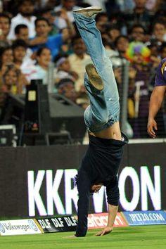 Bollywood star and co-owner of Kolkata Knight Riders Shahrukh Khan does a somersault after his team won the IPL Twenty20 first playoff cricket match between Delhi Daredevils and Kolkata Knight Riders at  Subrata Roy Sahara Stadium in Pune on May 22, 2012.