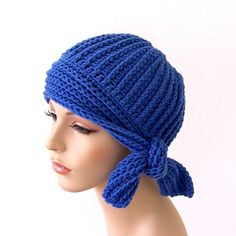 Reminiscent of the flapper style hats of the 1920s, this stylish crochet cloche pattern, with its feminine side tie, is quick, easy and fun to create!
