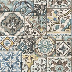 Traditional Mediterranean and arabesque blue green, yellow and brown tile design wallpaper that is evocative of Morocco.