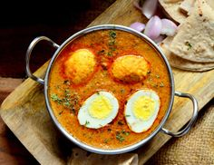 Creamy and rich malai, Dimer Malai Curry with hard boiled and fried eggs best goes with tawa chapati or plain steamed rice.