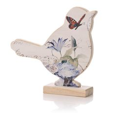 LOVE this little bird - inspiration only - cut bird shape from wood, made into a stand - decoupaged butterfly and flower images on front - one of my favorite projects! #ShabbyChic #Bird #Butterfly #Crafts - tå√