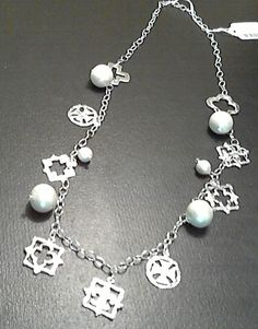 SILVER NECKLACE WITH PEARL BALL, AND SILVER CUT-OUT STATIONS