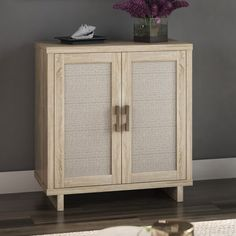 This cabinet adds texture and depth to your space with the unique look of this accent cabinet fit for any room. Linen-inspired cabinet doors offer a cool, look and conceal two interior shelves that are adjustable. It is perfect for stylish storage of books and supplies in your home office or holding movies and games in your living room, this cabinet offers multipurpose storage solutions. It with cutouts in the back panel for managing cords, it is also a great option for holding electronic…